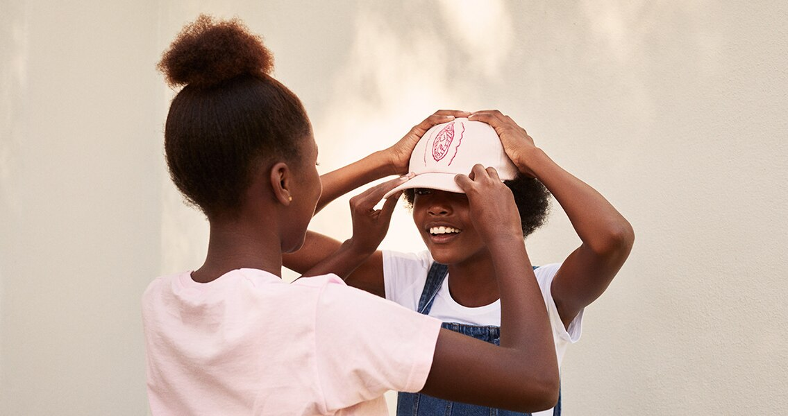 Woman putting a hat on her child